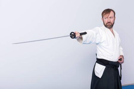 bushido: A man with katana on Iaido practice