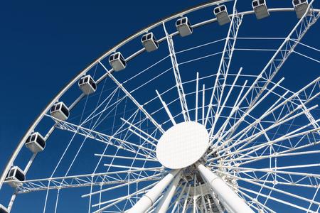 ferriswheel: Ferris wheel over a blue sky