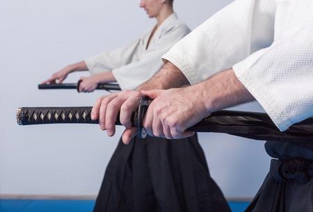 Hands holding the Katana