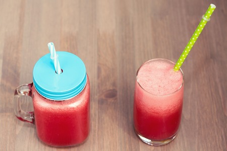 horozontal: Watermelon smoothie in a mason jar and a glass