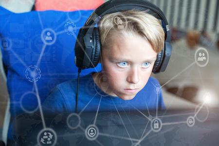 Teenage boy playing computer games on PC