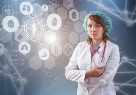 Beautiful female doctor and virtual computer interface Stock Photo