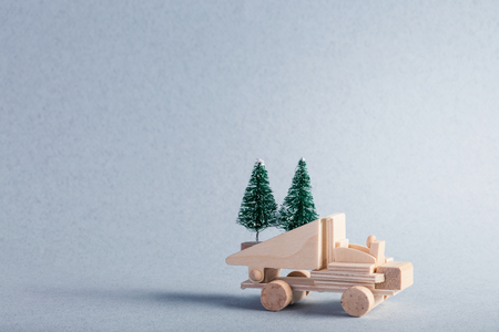 Wooden toy truck with christmas tree on is top Stock Photo