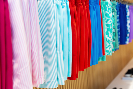 A variety of bright male swimsuits underwear for sale