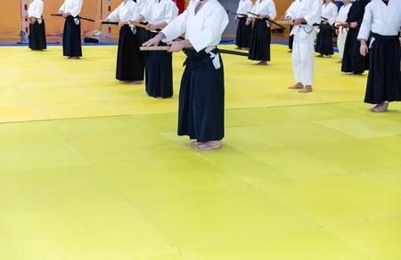 People in kimono on martial arts weapon training seminar Stok Fotoğraf