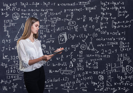Beautiful woman thinking how to solve a math problem Stock Photo