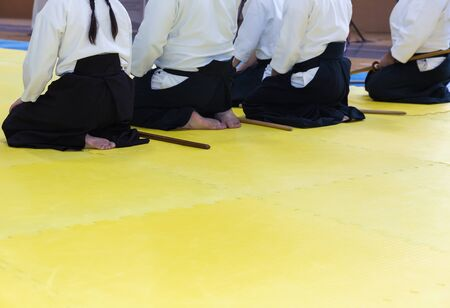 People in kimono on martial arts weapon training seminar Stock Photo