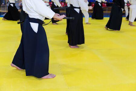 People in kimono on martial arts weapon training seminar Banco de Imagens