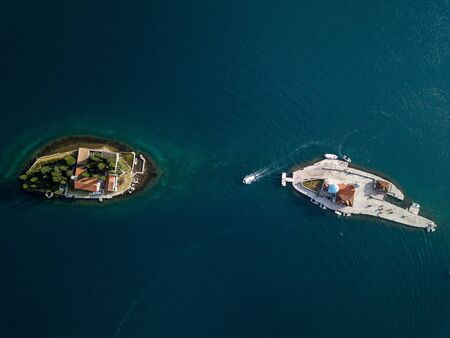 Aerial photo of St. George and monastery on the islands near Perast town in Kotor bay Banco de Imagens