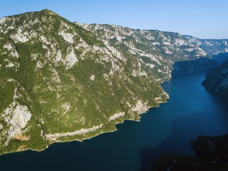 Aerial photo of a long winding road on Piva Lake in Montenegro Banco de Imagens
