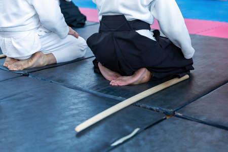 People in kimono on martial arts weapon training seminar Foto de archivo