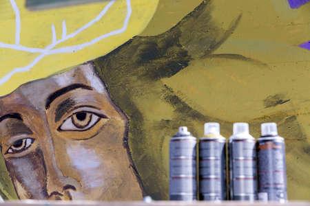 An original graffiti painting of a woman in helmet on a concrete wall Foto de archivo