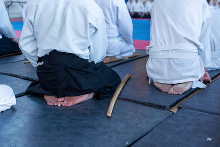 People in kimono on martial arts weapon training seminar 스톡 콘텐츠