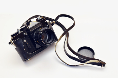 zenith: Old photo camera on a white background. Camera in leather carrying case with strap, lens. Zenit.