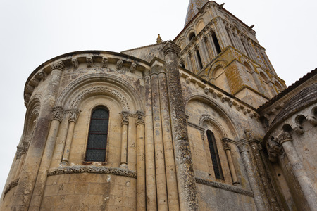 way of st james: Close-up abse and tower view of Aulnay de Saintonge church in Charente Maritime region of France