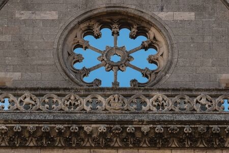 stoned: Stoned rose window and balustrade in main facade of gothic leon Cathedral in spain