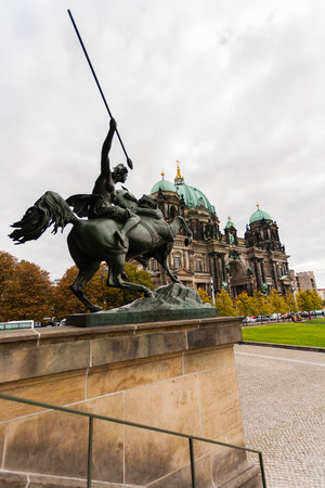 evangelical: Od view of the Evangelical cathedral also known as  Supreme Parish and Collegiate Church with  horseman in the forefront in Berlin ,Germany Stock Photo