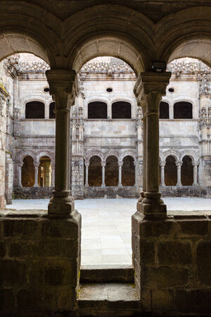 sil: Beautiful romanesque archery in the cloister of the manastery of santo estevo do rivas do sil located in the province of orense in Spain Stock Photo