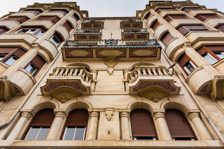 Upper view of a beautiful modernist building facade in the city of Bilbao Basque Country Spain Editorial