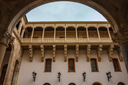 salina: Full view of stone carved balcony in the courtyard of Salina Palace located in Salamanca