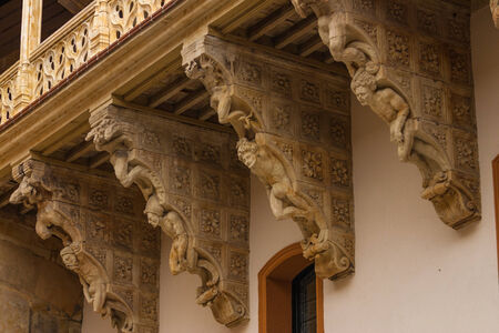 corbel: original corbel decoration in La Salina Palace courtyard with twisted carved bodies in Salamanca Spain