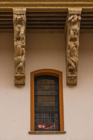 salina: Twisted bodies  carved in the corbels of Salina Palace courtyard located in Salamanca Spain