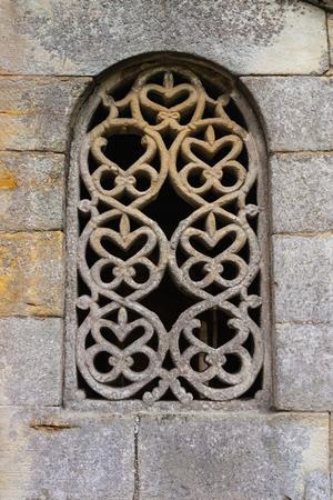 lattice window: Stunning lattice window in the pre-romanesque church of San Salvador de Valdedios circa IX century in Asturias Stock Photo