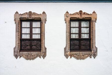 salina: Two beautiful decorated windows in a wall of the Salina Palace in Salamanca Spain