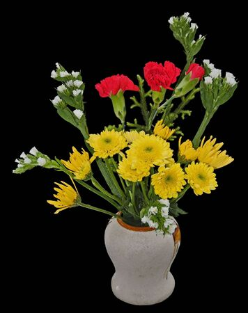 A welcome bouquet of flowers in a vase, isolated on black