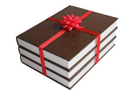 Gift of three books with red ribbons Stock Photo - 349866