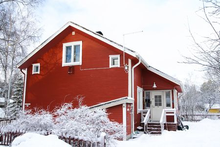 Red wooden Finnish house in winter Stock Photo - 2778602