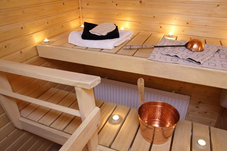 Interior of a Finnish sauna in candle light Stock Photo