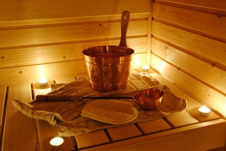 steam room: Interior of a Finnish sauna in candle light Stock Photo