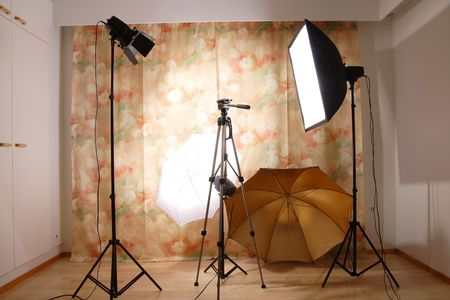 studio photography shot: Empty studio with flashes and tripod