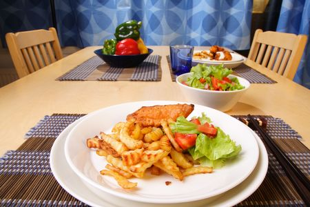 French fries and chicken legs on the plate with garlic sauce photo