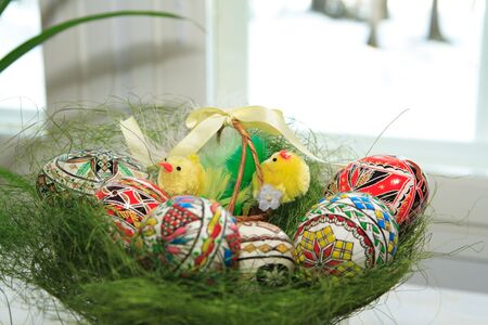 Hand painted Easter eggs in basket photo
