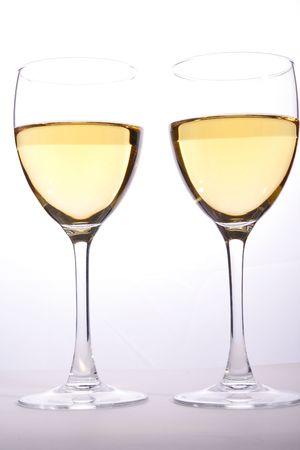 Wine glasses with white wine in studio light