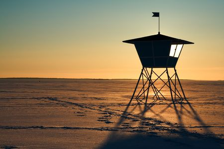 Life-guards hut during sunset in winter photo