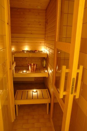 perspire: Interior of a Finnish sauna in candle light Stock Photo