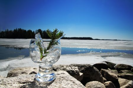 edge of the ice: Glasses with ice on the edge of a frozen lake