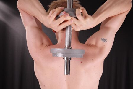 Man training with weight in dramatic studio light Stock Photo - 3024284