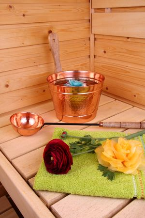 perspire: Interior of a Finnish sauna with flower and towel
