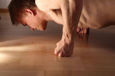 Man doing pushups in dramatic studio light Stock Photo - 3069061