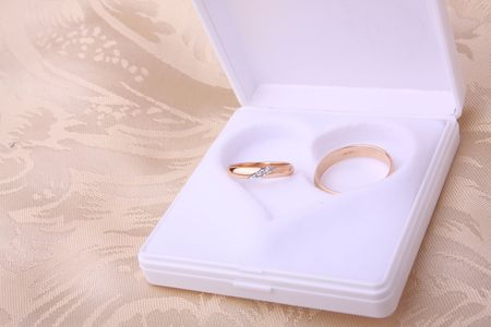Wedding rings in jewelry box with heart shape photo