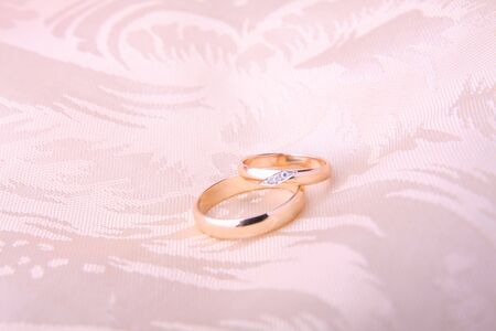 Wedding rings on satin shushion surface photo