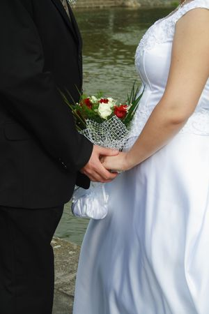 Just Married. Hands and bridal bouquet photo