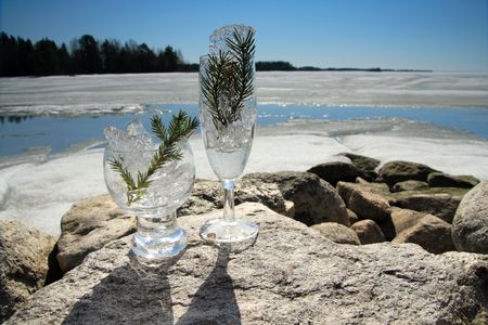 Glasses with ice on the edge of a frozen lake Stock Photo - 3150079