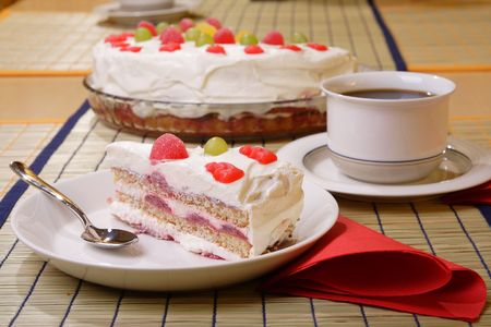 Slice of strawberry and cream cake on a plate photo