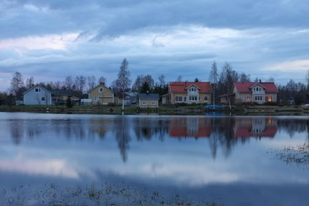 Wooden houses on the lake shore in Finland
