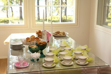 Table set with coffee cups and sweets for reception photo